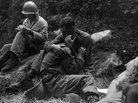 WWII Soldiers hugging on the battlefield