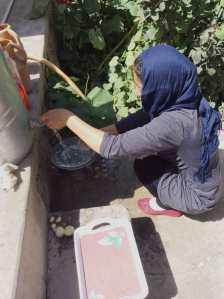 Zahidi washing dishes in our garden Sherri Maurin